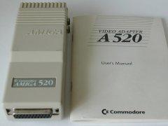 The Amiga A520 TV modulator with manual.