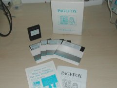 Page Fox with diskettes, manuals and original packaging.