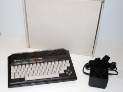 The Commodore 232 with original packaging and power supply.