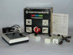 De Commodore 3000H met originele verpakking, gebruiksaanwijzing en voeding adapter.