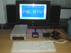A hacked C64 DTV-2 with diskdrive and keyboard.